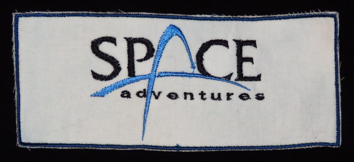 Soyouz TMA-16: Les badges privés de Guy LALIBERTE SPACE%20Adv