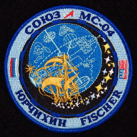 Le badge de l'EVA 43 SoyMS04
